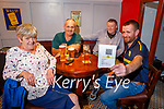 Fergus O'Connor holding his vaccine passport and enjoying the reopening of the Shoemaker Bar in Castleisland on Monday, l to r: Kathleen McGillicuddy, Martin Nolan, John Carty and Fergus O'Connor.