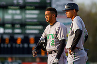 Clinton LumberKings outfielder Luis Liberato (2) and coach Luis Caballero (5) look on from first base during a Midwest League game against the Wisconsin Timber Rattlers on May 9th, 2016 at Fox Cities Stadium in Appleton, Wisconsin.  Clinton defeated Wisconsin 6-3. (Brad Krause/Four Seam Images)