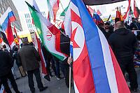 """250 bis 300 Menschen demonstrierten am Samstag den 31. Oktober 2015 in Berlin fuer die Unterstuetzung des syrischen Diktators Assad durch Russland. Sie trugen Fahnen Syriens, der ehemaligen Sowietunion, Russlands, Nordkoreas (recht im Bild), der DDR, des Iran und Venezuelas, die sich """"alle zusammen gegen den Imperialismus zur Wehr setzen"""" wuerden. Russlands Praesident Putin wurde ausdruecklich fuer sein Militaerengagement gedankt, das Eingreifen der USA verurteilt.<br /> 31.10.2015, Berlin<br /> Copyright: Christian-Ditsch.de<br /> [Inhaltsveraendernde Manipulation des Fotos nur nach ausdruecklicher Genehmigung des Fotografen. Vereinbarungen ueber Abtretung von Persoenlichkeitsrechten/Model Release der abgebildeten Person/Personen liegen nicht vor. NO MODEL RELEASE! Nur fuer Redaktionelle Zwecke. Don't publish without copyright Christian-Ditsch.de, Veroeffentlichung nur mit Fotografennennung, sowie gegen Honorar, MwSt. und Beleg. Konto: I N G - D i B a, IBAN DE58500105175400192269, BIC INGDDEFFXXX, Kontakt: post@christian-ditsch.de<br /> Bei der Bearbeitung der Dateiinformationen darf die Urheberkennzeichnung in den EXIF- und  IPTC-Daten nicht entfernt werden, diese sind in digitalen Medien nach §95c UrhG rechtlich geschuetzt. Der Urhebervermerk wird gemaess §13 UrhG verlangt.]"""