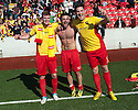 Albion Rovers' goal scorers Chris Cadden, Gary Fisher and John Gemmell celebrate with the fans at the end of the game after winning the SPFL League Two.