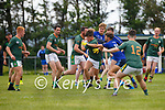 Finuge's Liam O'Brien gathers the loos ball and pulls free of Renard's Mark Sugrue, Brian Sugrue and Will Galvin.