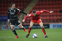 Sam Matthews of Crawley Town and Craig Clay of Leyton Orient during Leyton Orient vs Crawley Town, Sky Bet EFL League 2 Football at The Breyer Group Stadium on 19th December 2020