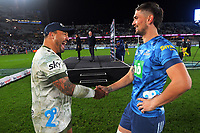 Ash Dixon and Otere Black shake hands after the Super Rugby Tran-Tasman final between the Blues and Highlanders at Eden Park in Auckland, New Zealand on Saturday, 19 June 2021. Photo: Dave Lintott / lintottphoto.co.nz