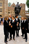 Girls sisters dress up in brothers traditional school uniform UK Eton College. Parents Day 4 June. 1990s,