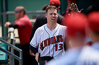 Indianapolis Indians Jake Elmore (13) high fives teammates during an International League game against the Syracuse Mets on July 17, 2019 at Victory Field in Indianapolis, Indiana.  Syracuse defeated Indianapolis 15-5  (Mike Janes/Four Seam Images)