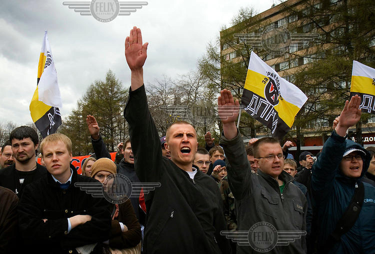 """Neo-Nazi demonstrators salute and chant """"Sieg Heil"""" (""""Hail Victory!"""") during a rally held to celebrate Hitler's birthday."""