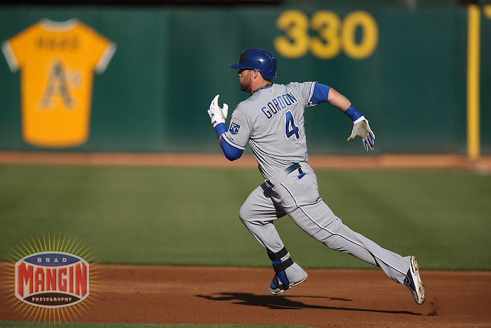 OAKLAND, CA - MAY 18:  Alex Gordon #4 of the Kansas City Royals runs the bases against the Oakland Athletics during the game at O.co Coliseum on Saturday May 18, 2013 in Oakland, California. Photo by Brad Mangin
