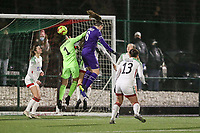 Tine De Caigny (6) of Anderlecht and Goalkeeper Louise Van Den Bergh (1) of OHL battle for the ball during a female soccer game between Oud Heverlee Leuven and RSC Anderlecht on the 12 th matchday of the 2020 - 2021 season of Belgian Womens Super League , sunday 31 st of January 2021  in Heverlee , Belgium . PHOTO SPORTPIX.BE | SPP | SEVIL OKTEM