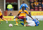 Motherwell v St Johnstone...30.08.14  SPFL<br /> Zaine Francis-Angol is tcakled by Lee Croft<br /> Picture by Graeme Hart.<br /> Copyright Perthshire Picture Agency<br /> Tel: 01738 623350  Mobile: 07990 594431