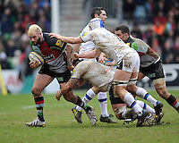 Joe Marler of Harlequins forces his way through Mat Gilbert of Bath Rugbyduring the Aviva Premiership match between Harlequins and Bath Rugby at the Twickenham Stoop on Saturday 13th April 2013 (Photo by Rob Munro)