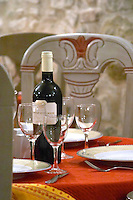 Chateau Guilhem. Carcassonne. At the Restaurant Auberge des Lices. Languedoc. France. Europe. Bottle. Wine glass.