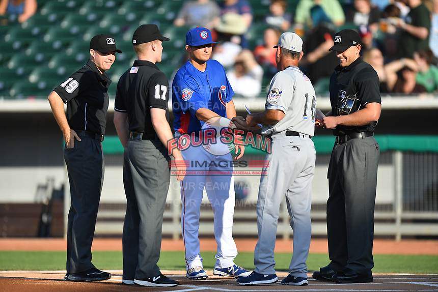 First base umpire Lew Williams, third base umpire Matt Winter, Tennessee Smokies infielder Kevin Cornelius (44), Biloxi Shuckers manager Mike Guerrero (13) and home plate umpire Brock Ballou greet each other before a game between the Shuckers and the Smokies at Smokies Stadium on May 26, 2017 in Kodak, Tennessee. The Smokies defeated the Shuckers 3-2. (Tony Farlow/Four Seam Images)