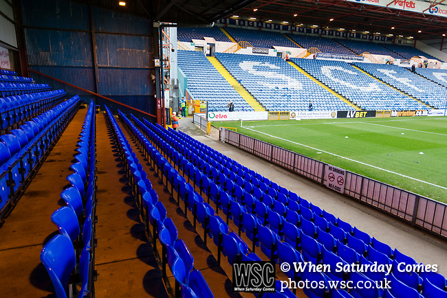 Blue seats and corrugated iron in The Popular Side. Stockport County v Barnet, 07032020. Edgeley Park, National League. Photo by Paul Thompson.