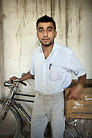A man stands with his Chinese made Phoenix brand bicycle.