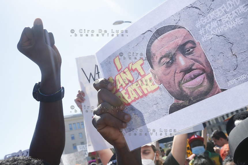 People reacts during a demonstration against police brutality, in solidarity with George Floyd and protesters