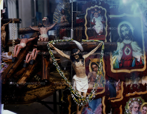 Chicago, Illinois<br /> USA<br /> April 2010<br /> <br /> A statue of Jesus Christ on display inside a store as a Good Friday procession takes place in Pilsen Chicago. Pilsen is mostly a Mexican American community in Chicago.