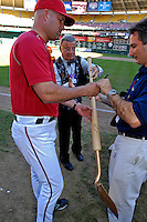 23 September 2007: Washington Nationals Manager Manny Acta signs a shovel used to remove home plate in a post-game ceremony commemorating the last professional baseball game played at Robert F. Kennedy Memorial Stadium in Washington, DC. The Nationals defeated the Philadelphia Phillies 5-3 to close out the 2007 season at RFK Stadium.. .Mandatory Photo Credit: Ed Wolfstein Photo