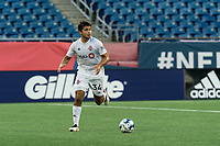 FOXBOROUGH, MA - JULY 9: Jon-Talen Maples #34 of Toronto FC II brings the ball forward during a game between Toronto FC II and New England Revolution II at Gillette Stadium on July 9, 2021 in Foxborough, Massachusetts.