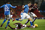 St Johnstone v Hearts..19.12.15  SPFL  McDiarmid Park, Perth<br /> Steven MacLean skips a tackle from Juwon Oshaniwa<br /> Picture by Graeme Hart.<br /> Copyright Perthshire Picture Agency<br /> Tel: 01738 623350  Mobile: 07990 594431