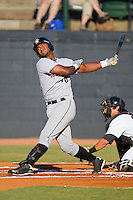 Jhonny Medrano #40 of the Greeneville Astros follows through on his swing against the Bristol White Sox at Boyce Cox Field July 2, 2010, in Bristol, Tennessee.  Photo by Brian Westerholt / Four Seam Images