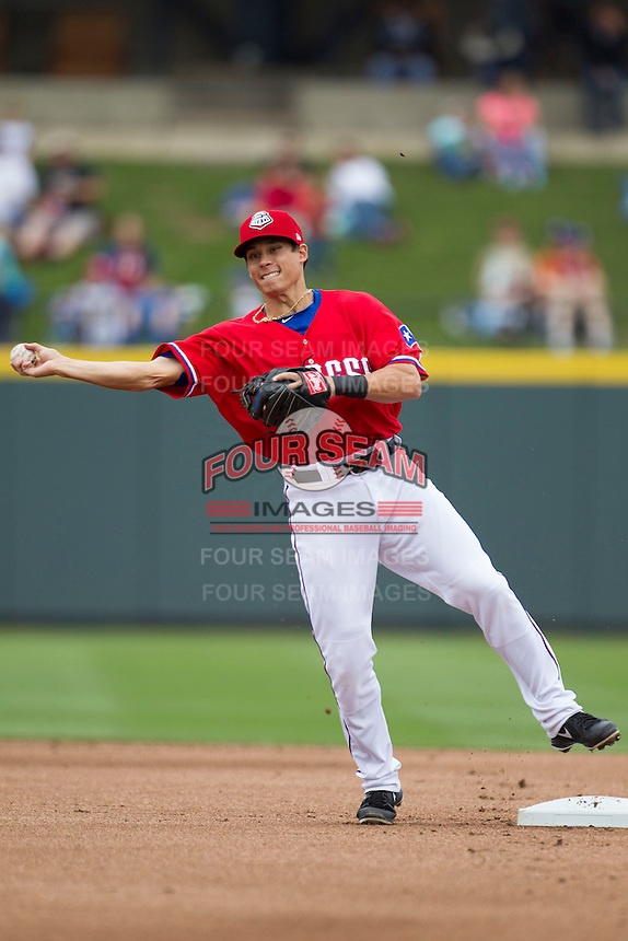 Round Rock Express shortstop Greg Miclat #2 makes a throw to first base against the Omaha Storm Chasers in the Pacific Coast League baseball game on April 7, 2013 at the Dell Diamond in Round Rock, Texas. Omaha beat Round Rock 5-2, handing the Express their first loss of the season. (Andrew Woolley/Four Seam Images).