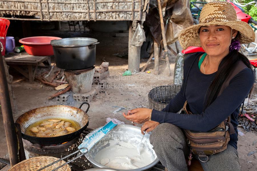 Cambodia.  Market near Siem Reap.  Woman Frying Food.