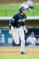 Christian Wolfe (21) of the UNCG Spartans hustles down the first base line against the Georgia Southern Eagles at UNCG Baseball Stadium on March 29, 2013 in Greensboro, North Carolina.  The Spartans defeated the Eagles 5-4.  (Brian Westerholt/Four Seam Images)