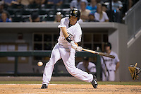 Tyler Colvin (26) of the Charlotte Knights at bat against the Indianapolis Indians at BB&T BallPark on June 20, 2015 in Charlotte, North Carolina.  The Knights defeated the Indians 6-5 in 12 innings.  (Brian Westerholt/Four Seam Images)