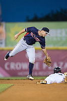 Luke Dykstra (4) of the Rome Braves leaps for the throw as Dylan Moore (6) of the Hickory Crawdads slides into second with a stolen base at L.P. Frans Stadium on May 12, 2016 in Hickory, North Carolina.  The Braves defeated the Crawdads 3-0.  (Brian Westerholt/Four Seam Images)