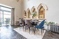 BNPS.co.uk (01202) 558833. <br /> Pic: LuxuryAndPrestige/BNPS<br /> <br /> Pictured: Dining space. <br /> <br /> A heavenly converted chapel that has been transformed into a contemporary home is on the market for £1.5m.<br /> <br /> The Old Chapel was used by an order of nuns for 139 years before the humble church got a stylish upgrade into a four-bedroom property.<br /> <br /> The Grade II listed building has been carefully restored to retain stunning ecclesiastical features like windows, archways and doors, but with a modern twist.<br /> <br /> And although the owner bought it from the developer before it was finished, the stunning home has never been lived in.