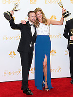 LOS ANGELES, CA, USA - AUGUST 25: Actor Aaron Paul and actress Anna Gunn, winners of Outstanding Drama Series Award, Outstanding Supporting Actor in a Drama Series Award and Outstanding Supporting Actress in a Drama Series for 'Breaking Bad' pose in the press room at the 66th Annual Primetime Emmy Awards held at Nokia Theatre L.A. Live on August 25, 2014 in Los Angeles, California, United States. (Photo by Celebrity Monitor)