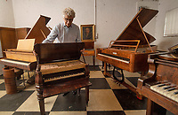 BNPS.co.uk (01202) 558833<br /> Pic: ZacharyCulpin/BNPS<br /> <br /> Pictured: The collection includes pianos of all shapes and sizes.<br /> <br /> A remarkable collection of rare pianos belonging to the Queen's personal restorer and conservator has emerged for sale for £250,000.<br /> <br /> David Winston is parting with 26 pianos he has amassed over the past 30 years dating from the 18th century to the present day.<br /> <br /> Mr Winston, who was awarded the Royal Warrant in 2012, is regarded as one of the foremost experts in his field and has restored pianos owned and played by Beethoven, Chopin and Liszt.<br /> <br /> His collection includes a 1925 Pleyel grand piano fitted with an original 'Auto Pleyela' self-playing mechanism in a spectacular Chinoiserie Louis XV case valued at 60,000.