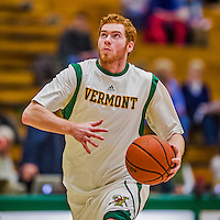 4 February 2014: University of Vermont Catamount Guard/Forward Harrison Taggart, a Redshirt Freshman from Wallingford, VT, warms up prior to facing the University of Maine Black Bears at Patrick Gymnasium in Burlington, Vermont. The Cats defeated the Bears 93-65 improving to 9-1 in America East and 15-9 overall. Mandatory Credit: Ed Wolfstein Photo *** RAW (NEF) Image File Available ***
