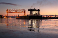 The thousand footer, American Integrity, quietly glided through the thing ice of the Duluth Harbor as it departed this morning.