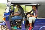 Fishing Cat (Prionailurus viverrinus) biologist, Maduranga Ranaweera, driving Anya Ratnayaka and Tharindu Bandara, in rickshaw, Urban Fishing Cat Project, Diyasaru Park, Colombo, Sri Lanka