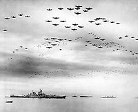F4U's F6F's fly in formation during surrender ceremonies; Tokyo, Japan.  USS MISSOURI (in) left foreground.  September 2, 1945. (Navy)<br /> NARA FILE #:  080-G-421130<br /> WAR & CONFLICT BOOK #:  1370