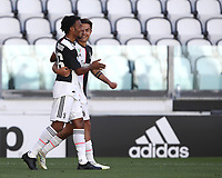 Calcio, Serie A: Juventus - Torino, Turin, Allianz Stadium, July 4, 2020.<br /> Juventus' Paulo Dybala (r) celebrates after scoring with his teamates Juan Cuadrado (l) during the Italian Serie A football match between Juventus and Torino at the Allianz stadium in Turin, July 4, 2020.<br /> UPDATE IMAGES PRESS/Isabella Bonotto