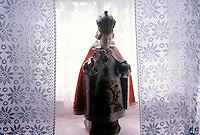 Infant of Prague statue in an Irish home with lace curtains, Ireland