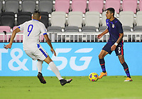 FORT LAUDERDALE, FL - DECEMBER 09: Julian Araujo #2 of the United States moves with the ball looking for an open man during a game between El Salvador and USMNT at Inter Miami CF Stadium on December 09, 2020 in Fort Lauderdale, Florida.