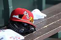 St Louis Cardinals hat, glove, and sunglasses on the bench during a spring training game against the Detroit Tigers at Roger Dean Stadium on March 28, 2012 in Jupiter, Florida.  Cardinals defeated the Tigers 9-5.  (Mike Janes/Four Seam Images)