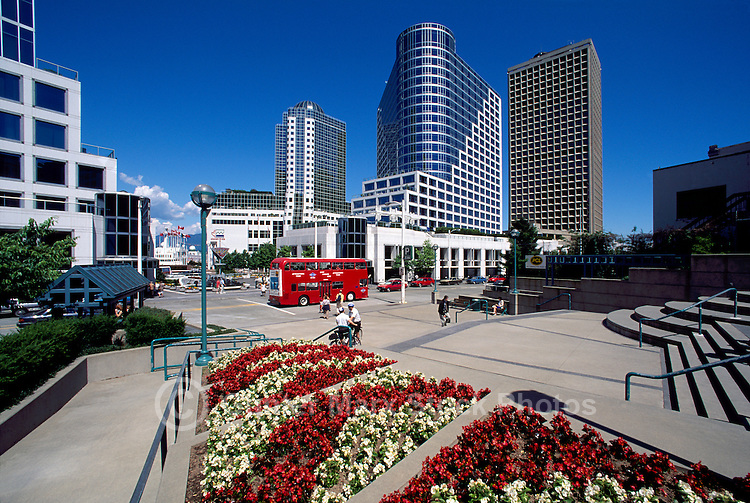 """Vancouver, BC, British Columbia, Canada - Sightseeing Tour Bus at """"Waterfront Centre"""" overlooking """"Canada Place"""" Trade and Convention Centre"""