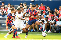 KANSAS CITY, KS - JULY 18: Miles Robinson #12 of the United States ,Cyle Larin #17 of Canada during a game between Canada and USMNT at Children's Mercy Park on July 18, 2021 in Kansas City, Kansas.