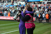 Joe Hart of Manchester City hugs Manchester City photographer during the Swansea City FC v Manchester City Premier League game at the Liberty Stadium, Swansea, Wales, UK, Sunday 15 May 2016