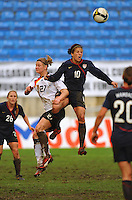 Carli Lloyd (right) and Germany's Alexandra Popp (left) collide in midair while challenging for a header. The USA captured the 2010 Algarve Cup title by defeating Germany 3-2, at Estadio Algarve on March 3, 2010.