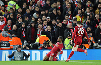 Liverpool's Georginio Wijnaldum (left) celebrates scoring the opening goal <br /> <br /> Photographer Rich Linley/CameraSport<br /> <br /> UEFA Champions League Round of 16 Second Leg - Liverpool v Atletico Madrid - Wednesday 11th March 2020 - Anfield - Liverpool<br />  <br /> World Copyright © 2020 CameraSport. All rights reserved. 43 Linden Ave. Countesthorpe. Leicester. England. LE8 5PG - Tel: +44 (0) 116 277 4147 - admin@camerasport.com - www.camerasport.com