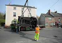 Pictured: The black Ford Fiesta is being recovered from Clifton Street in Laugharne, Carmarthenshire, Wales, UK. Monday 27 March 2017<br />