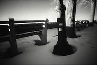 Back of park bench in snow<br />