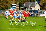 Naoise Mac Gearailt of An Ghaeltacht breaks from the tackles of Dominick Finnegan of Castleisland Desmonds against An Ghaeltacht in the Intermediate Club football Championship Quarter-Final