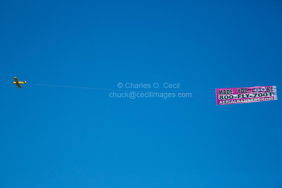 Ft. Lauderdale, Florida. Airplane Pulling Advertising Banner.