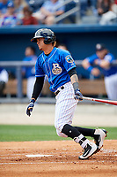 Biloxi Shuckers third baseman Angel Ortega (2) follows through on a swing during a game against the Jackson Generals on April 23, 2017 at MGM Park in Biloxi, Mississippi.  Biloxi defeated Jackson 3-2.  (Mike Janes/Four Seam Images)
